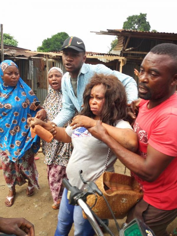 Female Child Kidnapper Caught In Lagos Beaten & Disgraced By Mob(pics) - Crime - Nigeria