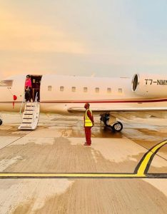 Regina in husband's jet